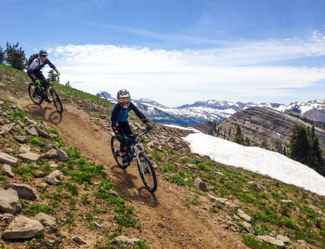 Gus Prissel leads dad, Mitch, opening weekend in the Grand Targhee Bike Park. The bike park will open for a bonus weekend September 26 and 27.