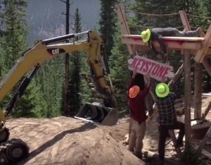 """Trail crews put the finishing touches on """"The Yacht,"""" a massive wooden finishing move on the new TNT."""