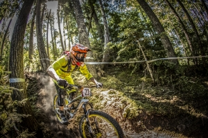 Bryan Regnier, of France, takes on the root-riddle Coastal rainforest Whistler is famous for in the 2014 SRAM Canadian Open Enduro, finishing 23rd with the 23 plate.