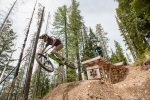 Sky Schillhammer leads Justin Bumgarner over a feature in Silver Mountain Bike Park.
