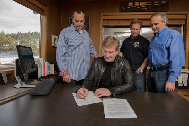 Mammoth Mountain chairman and CEO Rusty Gregory signs the Big Bear Mountain Resorts documents, finalizing the acquisition including Snow Summit Bike Park.