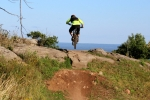 MTBParks ambassador Christopher Ridder hits a step-up on Calculated Risk with Lake Superior looming in the background.