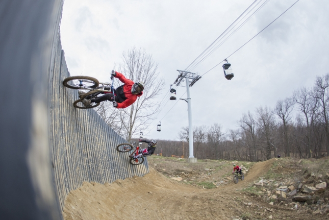 Riders session a wall ride at Mountain Creek.