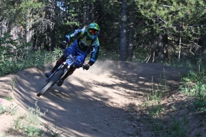 A racer rounds a corner during the downhill portion of a 2014 Pinnacle race at Evolution Bike Park.