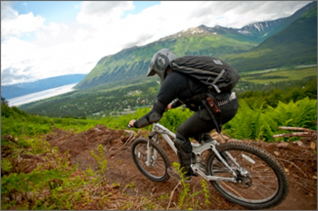 Kelly Wozencraft, a mountain bike patroller at Mt. Alyeska, keeps an eye out for downhill bikers.