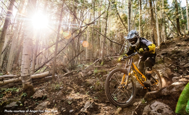 Sticks and Stones May Break Your Bones. Riding a technical trail at Angel Fire Bike Park.