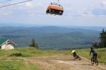 Riders drop into Evolution's newest flow trail from the summit.