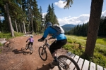 Riders drop into one of Mount Washington's trails prior to closing three years ago.
